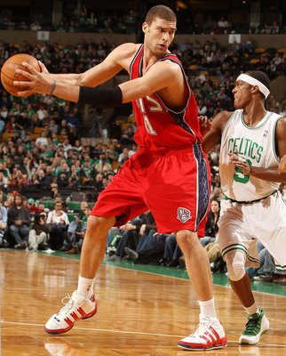 BOSTON - FEBRUARY 27:  Brook Lopez #11 of the New Jersey Nets looks to pass as Rajon Rondo #9  of the Boston Celtics defends at the TD Garden on February 27, 2010 in Boston, Massachusetts. The Nets defeated the Celtics 104-96.  NOTE TO USER: User expressl
