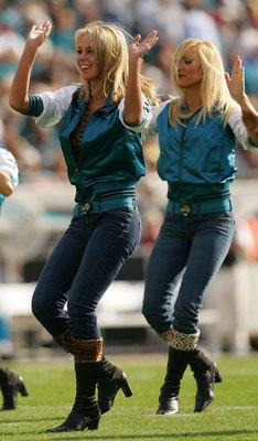 JACKSONVILLE, FL - DECEMBER 09: Jacksonville Jaguar cheerleaders dance in a game against the Carolina Panthers at Jacksonville Municipal Stadium on December 9, 2007 in Jacksonville, Florida.  (Photo by Sam Greenwood/Getty Images)