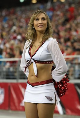 GLENDALE, AZ - NOVEMBER 01:  Arizona Cardinal's cheerleader performs during the NFL game against the Carolina Panthers at the Universtity of Phoenix Stadium on November 1, 2009 in Glendale, Arizona. The Panthers defeated the Cardinals 34-21.  (Photo by Ch