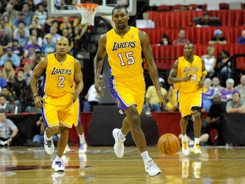 LAS VEGAS - OCTOBER 13:  Ron Artest #15 of the Los Angeles Lakers brings the ball up the court with teammates Derek Fisher #2 and Kobe Bryant #24 trailing during their preseason game against the Sacramento Kings at the Thomas & Mack Center October 13, 201
