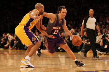 LOS ANGELES, CA - MAY 27:  Steve Nash #13 of the Phoenix Suns drives with the ball on Derek Fisher #2 of the Los Angeles Lakers in the third quarter of Game Five of the Western Conference Finals during the 2010 NBA Playoffs at Staples Center on May 27, 20