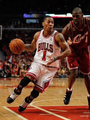 CHICAGO - APRIL 25: Derrick Rose #1 of the Chicago Bulls drives around Antawn Jamison #4 of the Cleveland Cavaliers in Game Four of the Eastern Conference Quarterfinals during the 2010 NBA Playoffs at the United Center on April 25, 2010 in Chicago, Illino