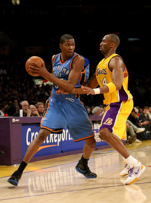 LOS ANGELES, CA - FEBRUARY 10:  Kevin Durant #35 of the Oklahoma City Thunder controls the ball against Kobe Bryant #24 of the Los Angeles Lakers on February 10, 2009 at Staples Center in Los Angeles, California.  The Lakers won 105-98.   NOTE TO USER: Us