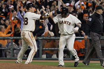 SAN FRANCISCO - OCTOBER 20:  Juan Uribe #5 of the San Francisco Giants celebrates with Buster Posey #28 after hitting a sacrifice fly that scored Aubrey Huff #17 to win 6-5 over the Philadelphia Phillies in Game Four of the NLCS during the 2010 MLB Playof