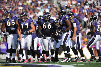 BALTIMORE, MD - OCTOBER 10: The Baltimore Ravens offensive line walks up to the line of scrimmage during the game against the Denver Broncos at M&T Bank Stadium on October 10, 2010 in Baltimore, Maryland. Players wore pink in recognition of Breast Cancer