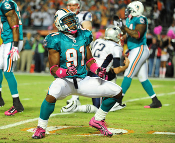 MIAMI - OCTOBER 4: Cameron Wake #91 of the Miami Dolphins celebrates after a play against the New England Patriots at Sun Life Field on October 4, 2010 in Miami, Florida. (Photo by Scott Cunningham/Getty Images)