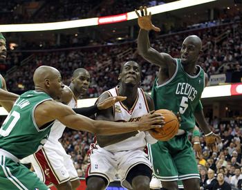 CLEVELAND - MAY 03:  J.J. Hickson #21 of the Cleveland Cavaliers tries to get around the defense of Ray Allen #20 and Kevin Garnett #5 of the Boston Celtics in Game Two of the Eastern Conference Semifinals during the 2010 NBA Playoffs at Quicken Loans Are