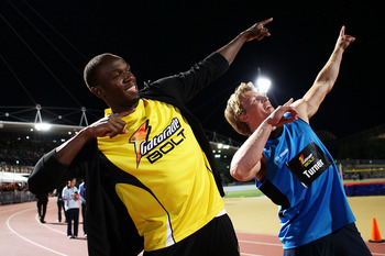 SYDNEY, AUSTRALIA - SEPTEMBER 15:  Usain Bolt of Jamaica (L) and Lachie Turner (R) pose after the 'Gatorage Bolt' during the Athletic Allstars Meet at Sydney Olympic Park Athletic Centre on September 15, 2010 in Sydney, Australia.  (Photo by Matt King/Get