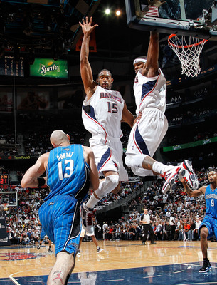 ATLANTA - MAY 10:  Al Horford #15 and Josh Smith #5 of the Atlanta Hawks defend the basket against Marcin Gortat #13 of the Orlando Magic during Game Four of the Eastern Conference Semifinals of the 2010 NBA Playoffs at Philips Arena on May 10, 2010 in At