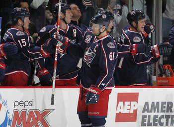 COLUMBUS, OH - OCTOBER 20:  Rick Nash #61 of the Columbus Blue Jackets is congradulated by teammates after a third period empty net goal against the Anaheim Ducks on October 20, 2010 at Nationwide Arena in Columbus, Ohio.  (Photo by Gregory Shamus/Getty I