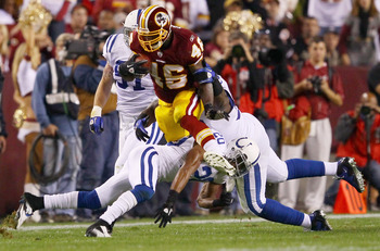 LANDOVER, MD - OCTOBER 17:  Running back Ryan Torain #46 of the Washington Redskins is gang tackled by the Indianapolis Colts defense at FedExField on October 17, 2010 in Landover, Maryland.  (Photo by Win McNamee/Getty Images)
