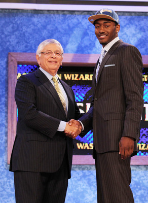NEW YORK - JUNE 24:  John Wall of Kentucky stands with NBA Commisioner David Stern after being drafted with the first pick by The Washington Wizards at Madison Square Garden on June 24, 2010 in New York, New York City. NOTE TO USER: User expressly acknowl