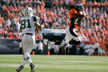DENVER - OCTOBER 17:  Corberback Syd'Quan Thompson #22 the Denver Broncos intercepts a pass intended for tight end Dustin Keller #81 of the New York Jets at INVESCO Field at Mile High on October 17, 2010 in Denver, Colorado.  (Photo by Justin Edmonds/Gett