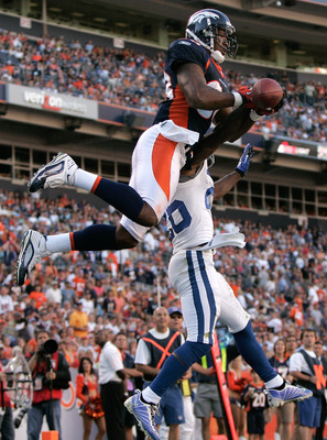 DENVER - SEPTEMBER 26:  Wide receiver Demaryius Thomas #88 of the Denver Broncos battles in the air with cornerback Kelvin Hayden #26 of the Indianapolis Colts during NFL action at INVESCO Field at Mile High on September 26, 2010 in Denver, Colorado. The