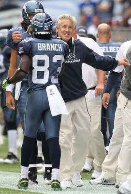 SEATTLE - SEPTEMBER 12:  Head coach Pete Carroll of the Seattle Seahawks hugs Deion Branch #83 after Deon Butler #11 scored a touchdown during the NFL season opener against the San Francisco 49ers at Qwest Field on September 12, 2010 in Seattle, Washingto