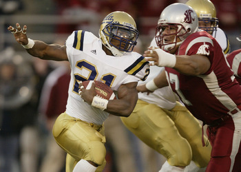 PULLMAN, WA - NOVEMBER 8:  Runningback Maurice Drew #21 of the U.C.L.A. Bruins rushes against Tai Tupai #97 of the Washington State University Cougars on November 8, 2003 at Martin Stadium in Pullman, Washington. (Photo by Otto Greule Jr/Getty Images)