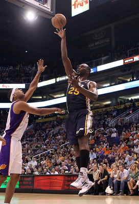 PHOENIX - OCTOBER 12:  Al Jefferson #25 of the Utah Jazz puts up a shot during the preseason NBA game against the Phoenix Suns at US Airways Center on October 12, 2010 in Phoenix, Arizona. NOTE TO USER: User expressly acknowledges and agrees that, by down
