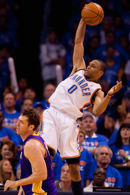 OKLAHOMA CITY - APRIL 30: Russell Westbrook #0 of the Oklahoma City Thunder pulls down a rebound against Luke Walton #4 of the Los Angeles Lakers during Game Six of the Western Conference Quarterfinals of the 2010 NBA Playoffs on April 30, 2010 at the For
