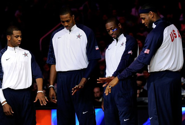 PHOENIX - FEBRUARY 15:  (L-R) Chris Paul, Dwight Howard, Dwyane Wade and LeBron James, members of the gold medal winning USA Olympic basketball team, admire their rings during half time of the 58th NBA All-Star Game, part of 2009 NBA All-Star Weekend at U