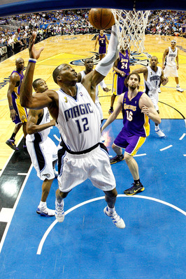 ORLANDO, FL - JUNE 09:  Dwight Howard #12 of the Orlando Magic grabs a rebound in Game Three of the 2009 NBA Finals against the Los Angeles Lakers on June 9, 2009 at Amway Arena in Orlando, Florida.  NOTE TO USER:  User expressly acknowledges and agrees t
