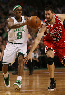 BOSTON - APRIL 28:  Brad Miller #52 of the Chicago Bulls tries to steal the ball from Rajon Rondo #9 of the Boston Celtics in Game Five of the Eastern Conference Quarterfinals during the 2009 NBA Playoffs at TD Banknorth Garden on April 28, 2009 in Boston