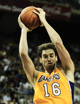 BARCELONA, SPAIN - OCTOBER 07:  Pau Gasol #16 of the Los Angeles Lakers grabs a rebound during the NBA Europe Live match between Los Angeles Lakers and Regal FC Barcelona at the at Palau Blaugrana on October 7, 2010 in Barcelona, Spain.  (Photo by David R
