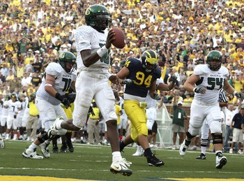 ANN ARBOR, MI - SEPTEMBER 08:  Dennis Dixon #10 of the Oregon Ducks high steps in for a second quarter touchdown in front of John Ferrara #94 of the Michigan Wolverines on September 8, 2007 at Michigan Stadium in Ann Arbor, Michigan.  (Photo by Gregory Sh