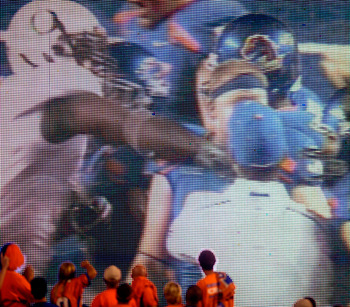 BOISE, ID - SEPTEMBER 3:  Boise State fans watch the video board as LaGarrette Blount #9 of the Oregon Ducks is shown punching a Boise State Broncos player after the game causing quite a commotion and talk of him being arrested on September 3, 2009 at Bro