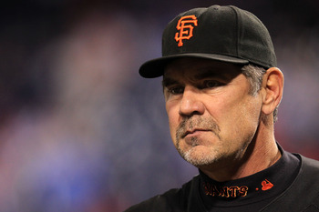 PHILADELPHIA - OCTOBER 17:  Manager Bruce Bochy of the San Francisco Giants looks on during batting practice before taking on the Philadelphia Phillies in Game Two of the NLCS during the 2010 MLB Playoffs at Citizens Bank Park on October 17, 2010 in Phila
