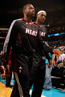 NEW ORLEANS - OCTOBER 13:  Lebron James #6 and Dwyane Wade #3 of the Miami Heat in action during the game against the New Orleans Hornets at the New Orleans Arena on October 13, 2010 in New Orleans, Louisiana.  NOTE TO USER: User expressly acknowledges an