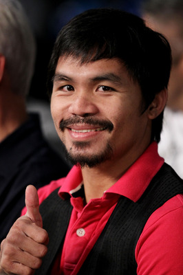 NEW YORK - JUNE 05:  Professional boxer Manny Pacquiao watches the bout between Yuri Foreman and Miguel Cotto of Puerto Rico in the WBA world super welterweight title fight on June 5, 2010 at Yankee Stadium in the Bronx borough of New York City. Cotto win