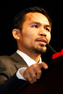 LAS VEGAS - DECEMBER 06:  Manny Pacquiao of the Philippines speaks at a news conference following his win over Oscar De La Hoya after their welterweight fight at the MGM Grand Garden Arena December 6, 2008 in Las Vegas, Nevada.  (Photo by Ethan Miller/Get