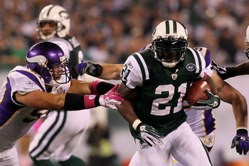 EAST RUTHERFORD, NJ - OCTOBER 11:  LaDainian Tomlinson #21 of the New York Jets runs the ball in the first half against Ben Leber #51 of the Minnesota Vikings at New Meadowlands Stadium on October 11, 2010 in East Rutherford, New Jersey.  (Photo by Jim Mc