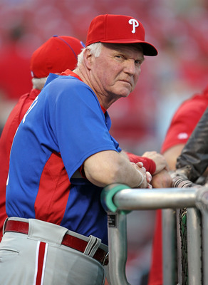 CINCINNATI - OCTOBER 10:  Charlie Manuel the manager of the Philadelphia Phillies watches batting practice before the start of Game 3 of the NLDS against the Cincinnati Reds at Great American Ball Park on October 10, 2010 in Cincinnati, Ohio.  (Photo by A