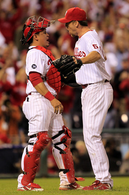 PHILADELPHIA - OCTOBER 08:  Carlos Ruiz #51 (L) and Brad Lidge #54 of the Philadelphia Phillies celebrate victory over the Cincinnati Reds in game 2 of NLDS at Citizens Bank Park on October 8, 2010 in Philadelphia, Pennsylvania. The Phillies defeated the