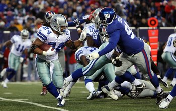 EAST RUTHERFORD, NJ - DECEMBER 06: Marion Barber #24 of the Dallas Cowboys runs the ball in the first quarter against Barry Cofield #96 of the New York Giants at Giants Stadium on December 6, 2009 in East Rutherford, New Jersey. (Photo by Jim McIsaac/Gett