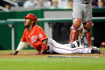 WASHINGTON - SEPTEMBER 24:  Willie Harris #22 of the Washington Nationals slides into home plate for an inside the park home run in the seventh inning against the Atlanta Braves at Nationals Park on September 24, 2010 in Washington, DC.  (Photo by Greg Fi
