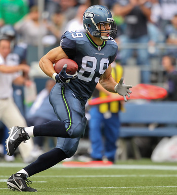 SEATTLE - SEPTEMBER 26:  Tight end John Carlson #89 of the Seattle Seahawks rushes against the San Diego Chargers at Qwest Field on September 26, 2010 in Seattle, Washington. (Photo by Otto Greule Jr/Getty Images)