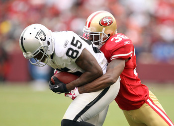 SAN FRANCISCO - OCTOBER 17:  Darrius Heyward-Bey #85 of the Oakland Raiders is tackled by Dashon Goldson #38 of the San Francisco 49ers at Candlestick Park on October 17, 2010 in San Francisco, California.  (Photo by Ezra Shaw/Getty Images)