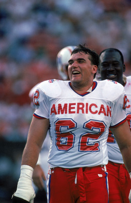 HONOLULU, HI - FEBRUARY 4:  Buffalo Bills offensive tackle Tunch Ilkin #62 of the AFC squad laughs during the 1990 NFL Pro Bowl at Aloha Stadium on February 4, 1990 in Honolulu, Hawaii.  The NFC won 27-21.  (Photo by George Rose/Getty Images)
