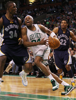 BOSTON - MARCH 10:  Paul Pierce #34 of the Boston Celtics tries to get around Hasheem Thabeet #34  of the Memphis Grizzlies on March 10, 2010 at the TD Garden in Boston, Massachusetts. The Grizzlies defeated the Celtics 111-91. NOTE TO USER: User expressl