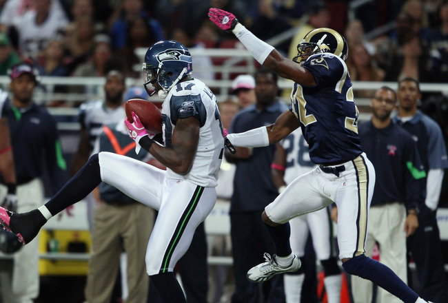 ST. LOUIS - OCTOBER 03:  Mike Williams #17 of the Seattle Seahawks makes the catch as Bradley Fletcher #32 of the St. Louis Rams defends on October 3, 2010 at Edward Jones Dome in St. Louis, Missouri.  (Photo by Elsa/Getty Images)