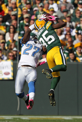 GREEN BAY, WI - OCTOBER 03: Alphonso Smith #27 of the Detroit Lions takes the ball away from Greg Jennings #85 of the Green Bay Packers for an interception at Lambeau Field on October 3, 2010 in Green Bay, Wisconsin. The Packers defeated the Lions 28-26.