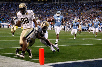 CHARLOTTE, NC - DECEMBER 26:  Jonathan Baldwin #82 of the Pittsburgh Panthers watches as teammate Dion Lewis #28 fumbles the ball at the goal line against the North Carolina Tar Heels during their game on December 26, 2009 in Charlotte, North Carolina.  (