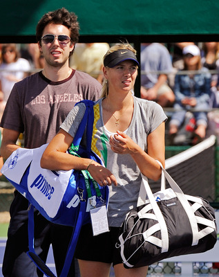 INDIAN WELLS, CA - MARCH 13:  Sasha Vujacic of the Los Angeles Lakers and Maria Shapova of Russia leave the court after her practice during the BNP Paribas Open on March 13, 2010 in Indian Wells, California.  (Photo by Kevork Djansezian/Getty Images)