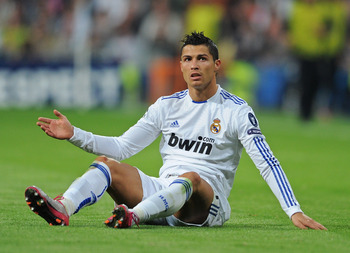 MADRID, SPAIN - OCTOBER 19:  Cristiano Ronaldo of Real Madrid sits on the pitch during the UEFA Champions League group G match between Real Madrid and AC Milan at the Estadio Santiago Bernabeu on October 19, 2010 in Madrid, Spain. Real Madrid won the matc