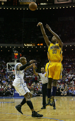 ORLANDO, FL - DECEMBER 07:  Danny Granger #33 of the Indiana Pacers shoots over Maurice Evans #1 of the Orlando Magic at Amway Arena on December 7, 2007 in Orlando, Florida. NOTE TO USER: User expressly acknowledges and agrees that, by downloading and or