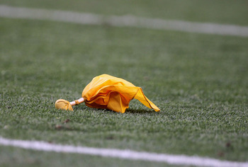 DENVER - AUGUST 21:  A penalty flag rests on the field after a call between the Denver Broncos and the Detroit Lions during preseason NFL action at INVESCO Field at Mile High on August 21, 2010 in Denver, Colorado. The Lions defeated the Broncos 25-20.  (