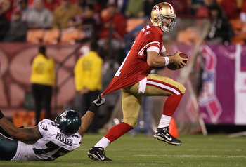 SAN FRANCISCO - OCTOBER 10:  Alex Smith #11 of the San Francisco 49ers is tackled by Juqua Parker #75 of the Philadelphia Eagles during an NFL game at Candlestick Park on October 10, 2010 in San Francisco, California.  (Photo by Jed Jacobsohn/Getty Images