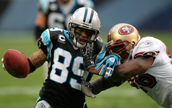 CHARLOTTE, NC - DECEMBER 02:  Steve Smith #89 of the Carolina Panthers is tackled by Mark Roman #26 of the San Francisco 49ers at Bank of America Stadium on December 2, 2007 in Charlotte, North Carolina.  (Photo by Streeter Lecka/Getty Images)